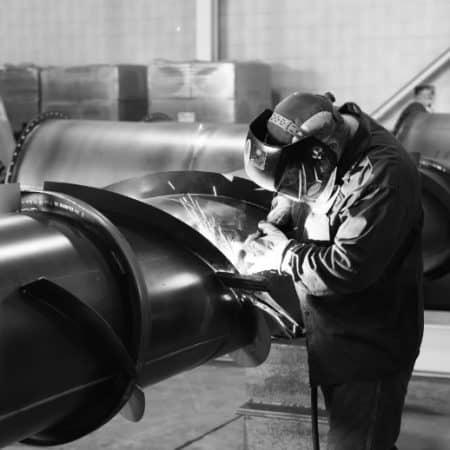 Fabricator welding a stack